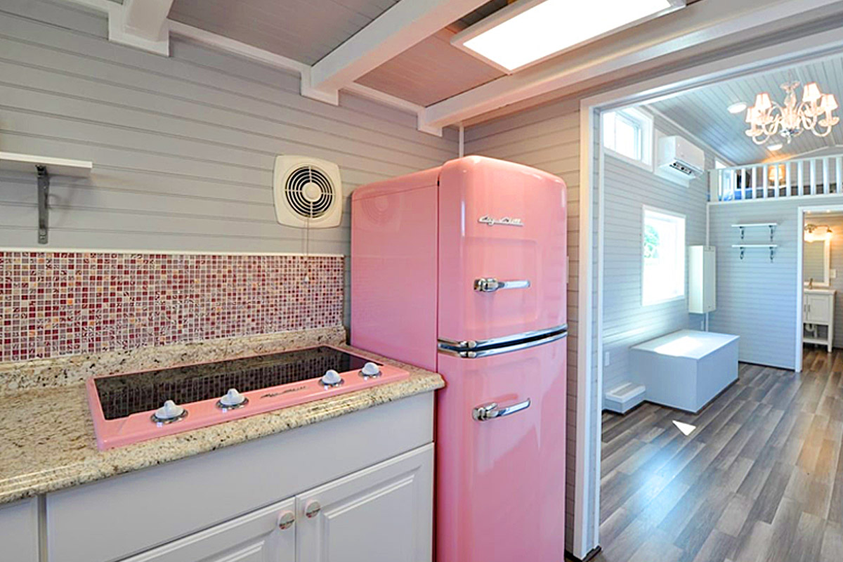 Tiny Home With Retro Style Pink kitchen appliances  Getaway